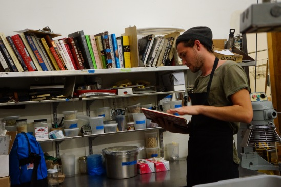 Jacob Wolf, flipping through cookbooks