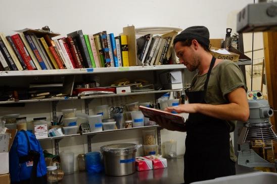 Jacob Wolf, flipping through cookbooks